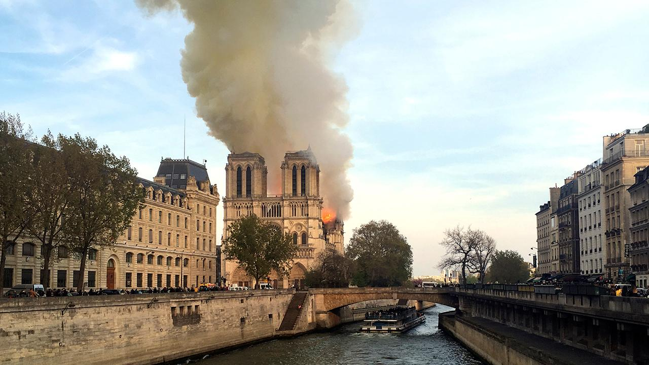 Notre Dame fire: YouTube slammed after live footage appears with link to 9/11 info