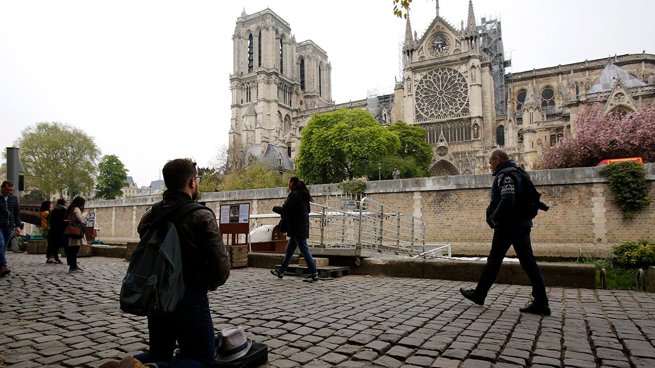 Tourist searching for people in 'historic' Notre Dame Cathedral photo taken one hour before fire