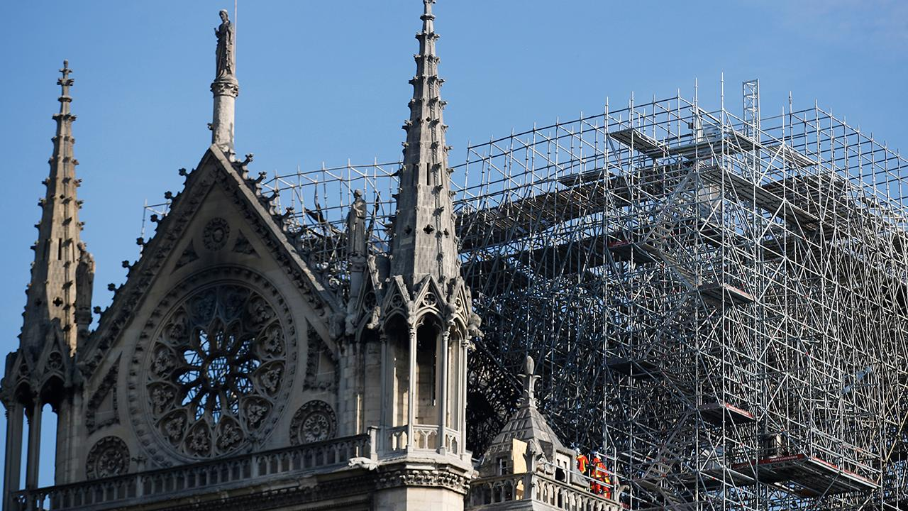 How will Notre Dame rebuild following catastrophic fire?