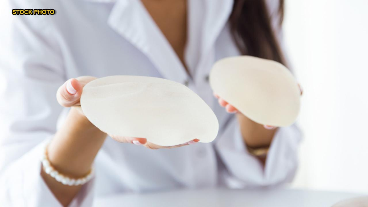 Breast implants tied to rare cancer to remain on US market