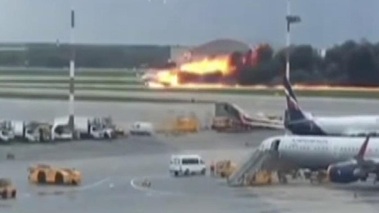 Officials and passengers react to Moscow plane fire