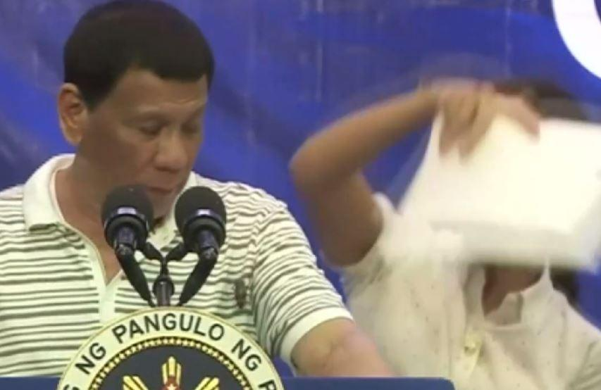 President Rodrigo Duterte of the Philippines gets interrupted by a cockroach during rally