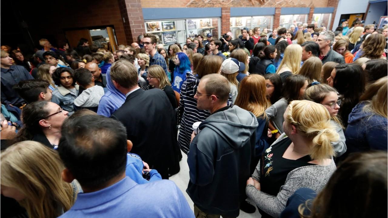 Colorado students walk out of school shooting vigil