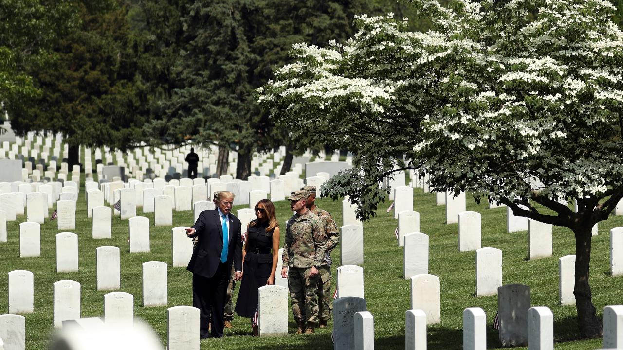 President Trump and first lady Melania Trump pay respects to fallen soldiers at Arlington National Cemetery