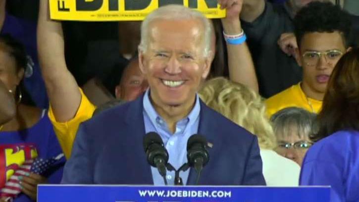 2020 Democrats take aim at absent Biden in Iowa