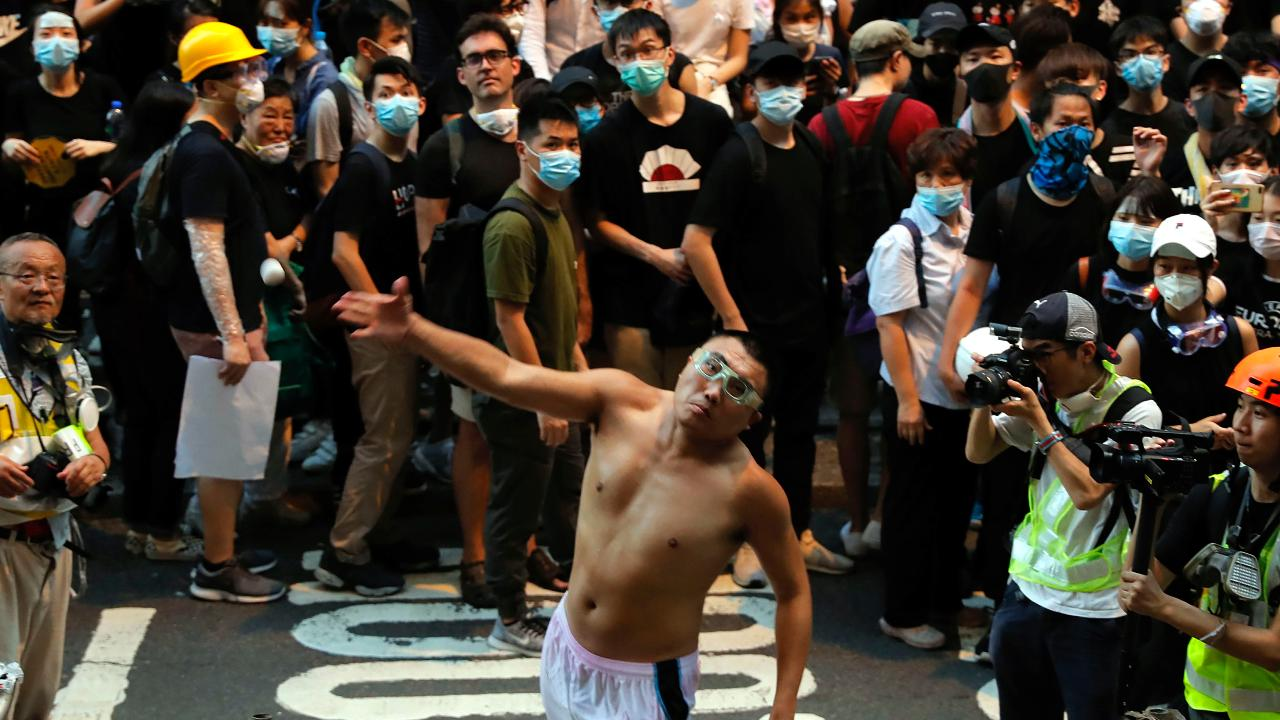 Demonstrators in Hong Kong shut down police headquarters