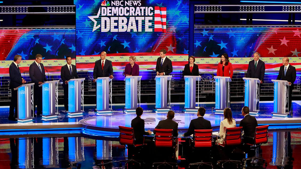 Democratic 2020 hopefuls tout liberal credentials at first presidential debate