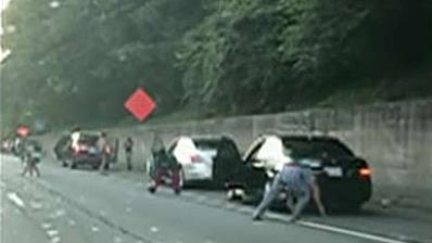 Armored car spills thousands of dollars on Georgia highway, drivers run out of vehicles to grab the cash