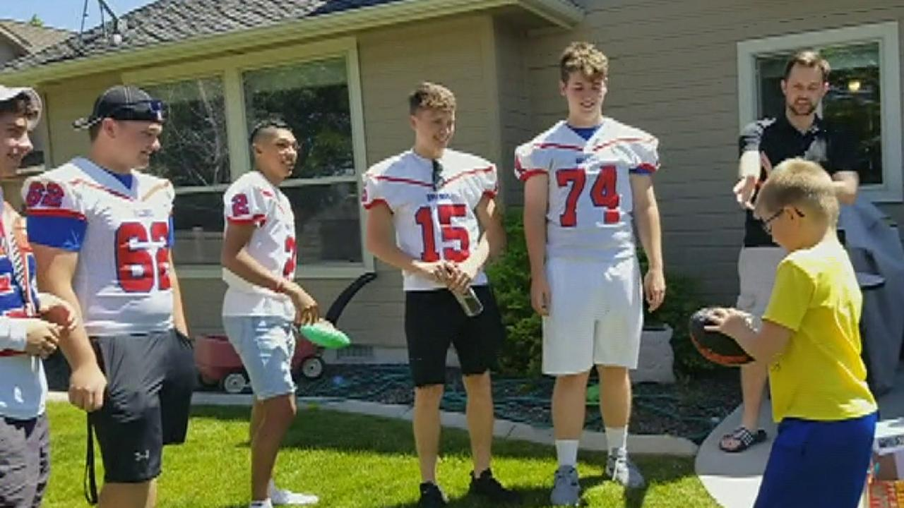 Raw video: Local high school football players give autistic fan the 'best birthday ever'