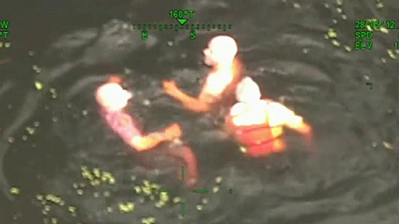 Raw video: Florida officers jump into river in pursuit of suspect