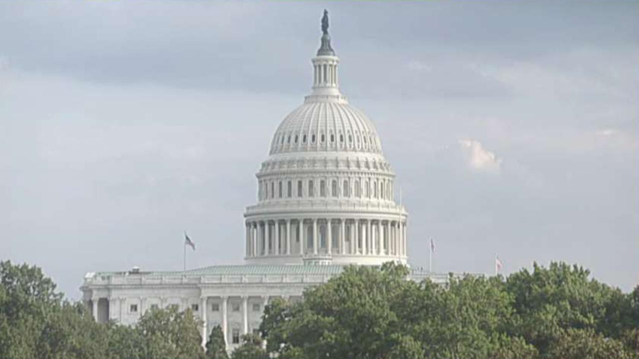House approves budget and debt limit deal
