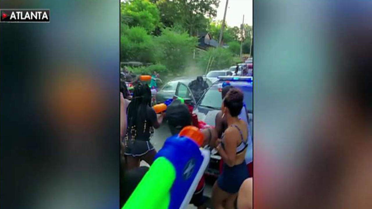 Police officers drenched with water in multiple cities