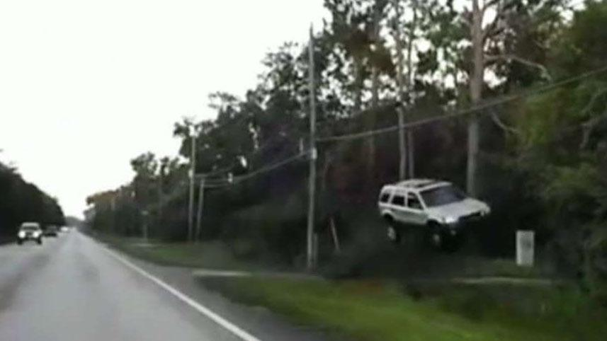 Westlake Legal Group 694940094001_6067645795001_6067655356001-vs Off-duty Florida police officer jumps into action after SUV goes airborne, hits trees before landing fox-news/us/us-regions/southeast/florida fox-news/us/crime/police-and-law-enforcement fox-news/auto fox news fnc/us fnc f8aac4b5-b45a-5696-acea-216eaa61eefe David Aaro article