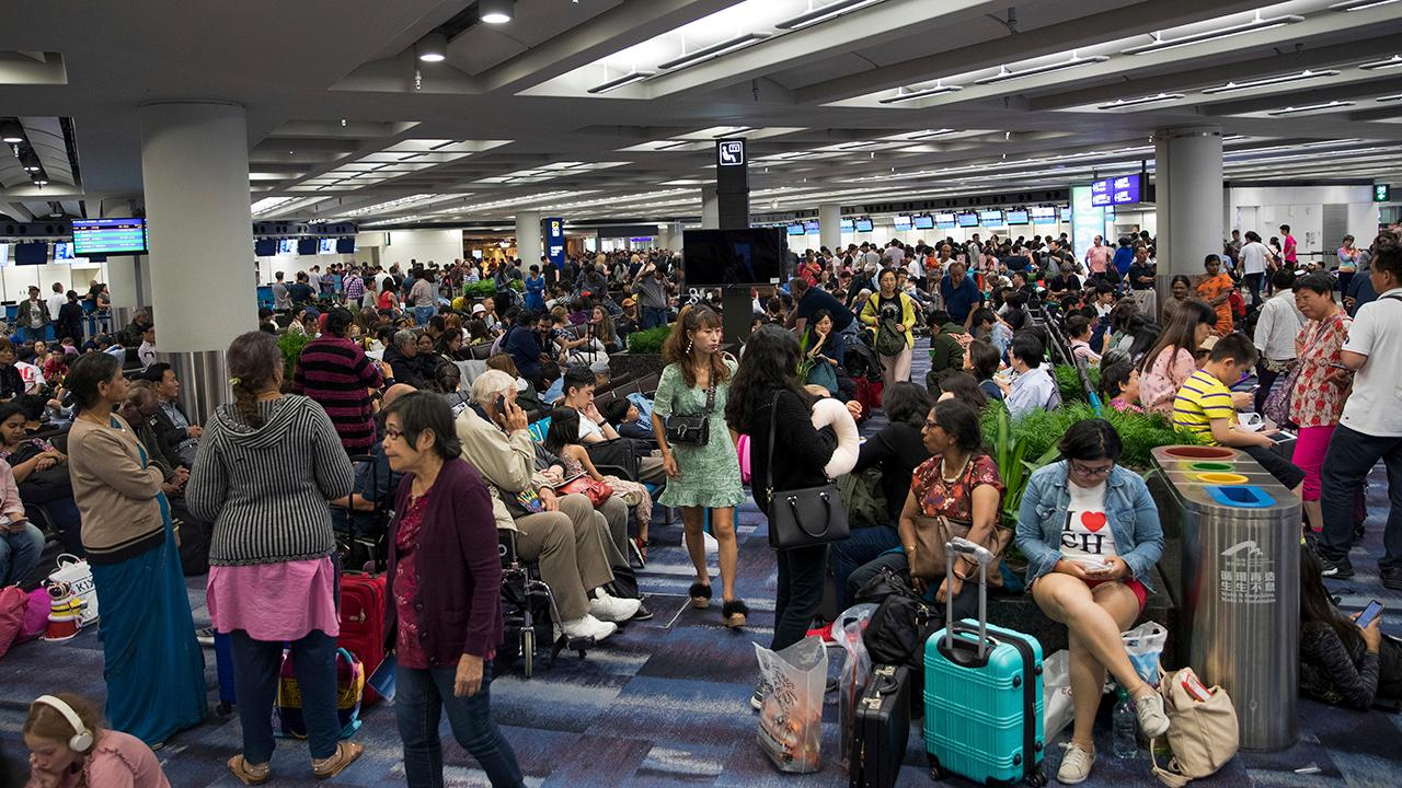 Hong Kong airport shut down after thousands of protesters swarm terminal