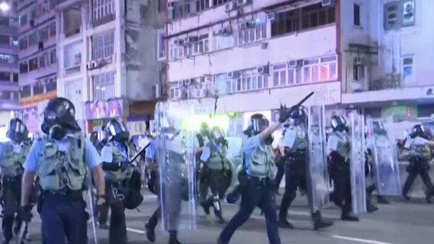 Hong Kong riot police blanket streets in standoff with protesters