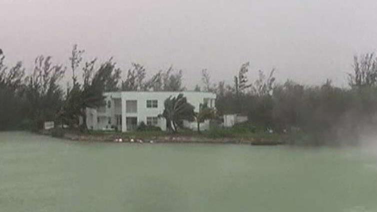 Woman riding out Hurricane Dorian says most areas of Grand Bahama are underwater