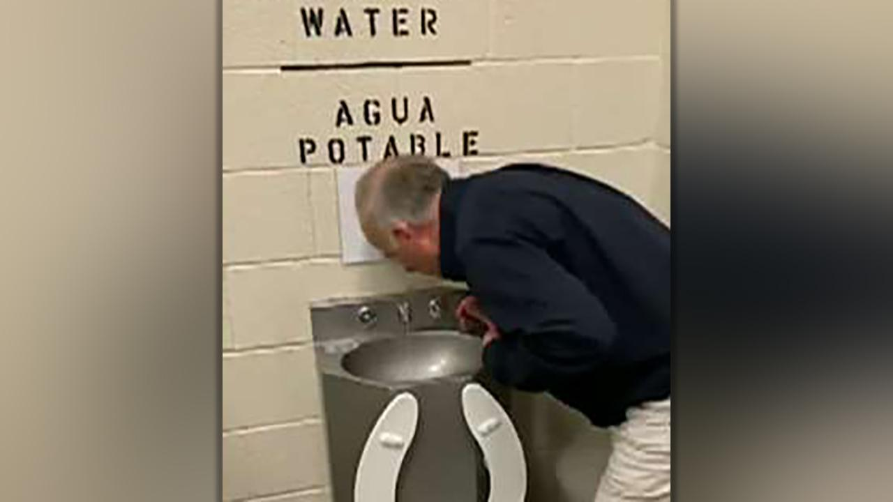 AOC fires back after Rep. Steve King posts video of himself drinking water from sink at detention center