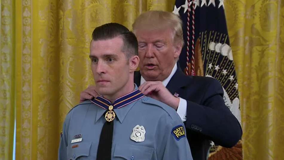 Officers and civilians honored at the White House for their response to mass shootings in Dayton and El Paso