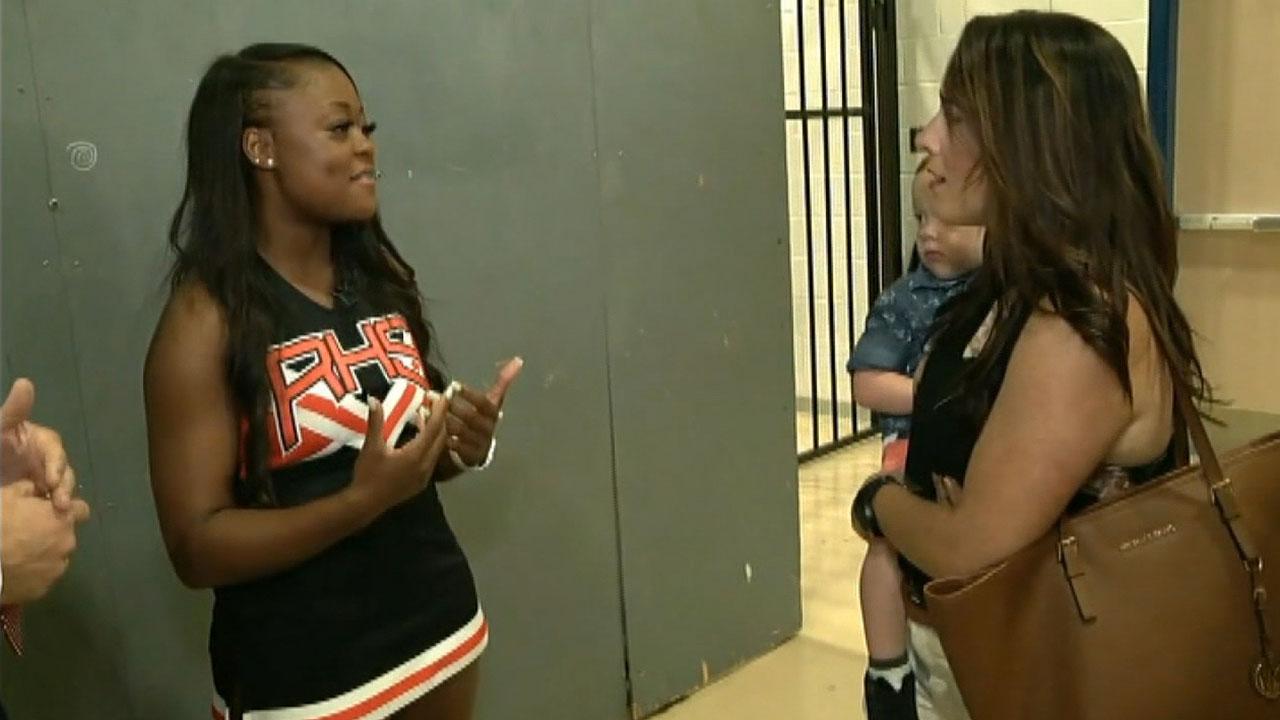 Texas cheerleader saves choking toddler during homecoming parade