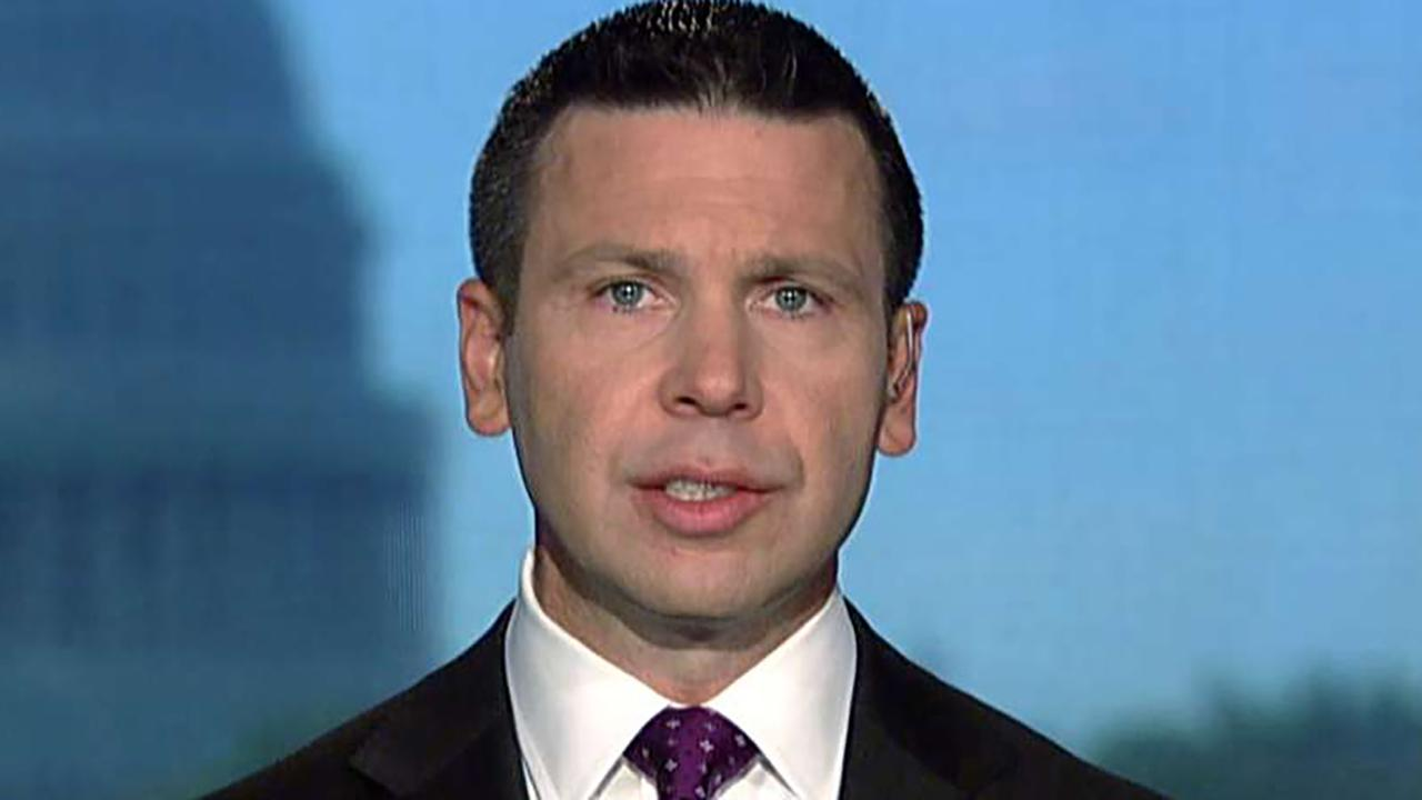McAleenan reacts to being shouted off theatre during Georgetown Law School