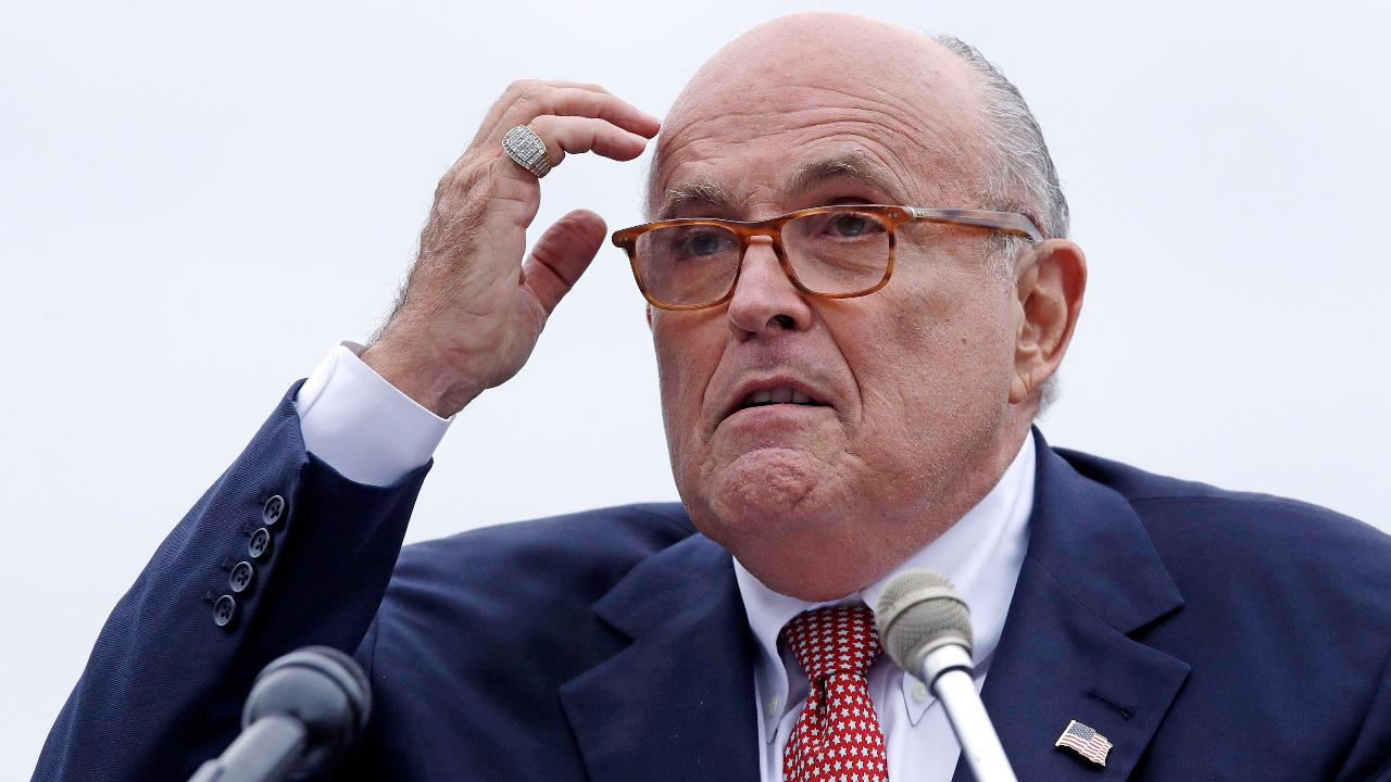 Rudy Giuliani finds timing of clients' arrest and indictment suspicious