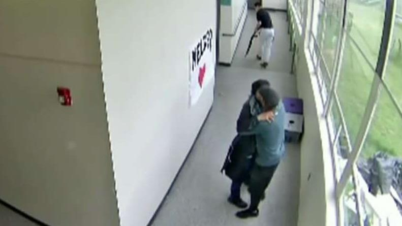 Oregon high school football coach disarms and hugs student carrying loaded shotgun