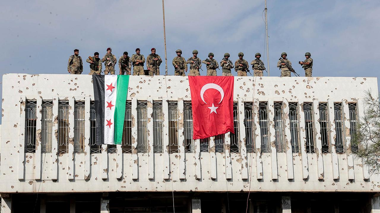 Russian military forces move into Syria to help Turkey keep Kurds away from border