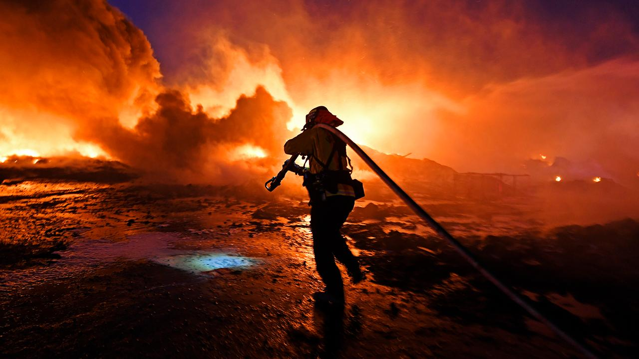 Crews fighting California wildfires in race against the clock ahead of new round of Santa Ana winds
