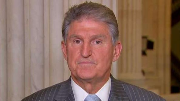 Sen. Manchin doesn't back Bernie for president, refuses to answer if he would vote for Trump
