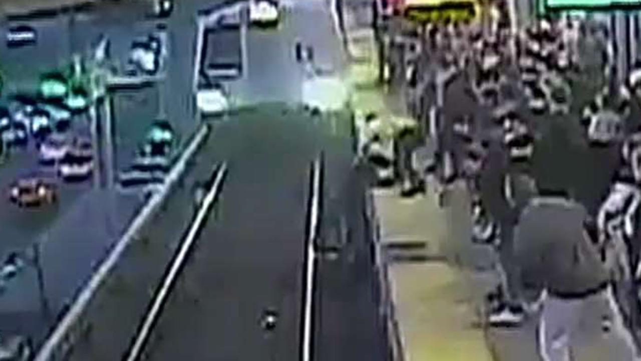 Transit worker pulls man out of path of oncoming train in California