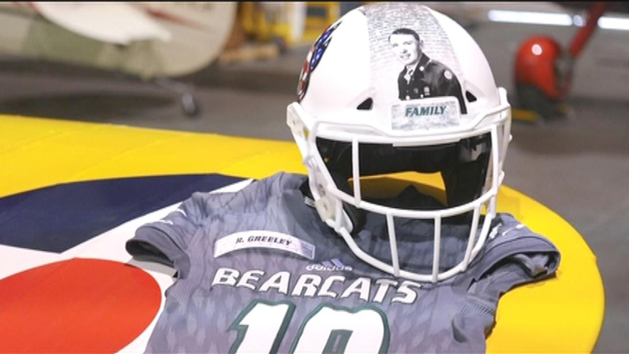 College football team wears images of military veterans on helmets