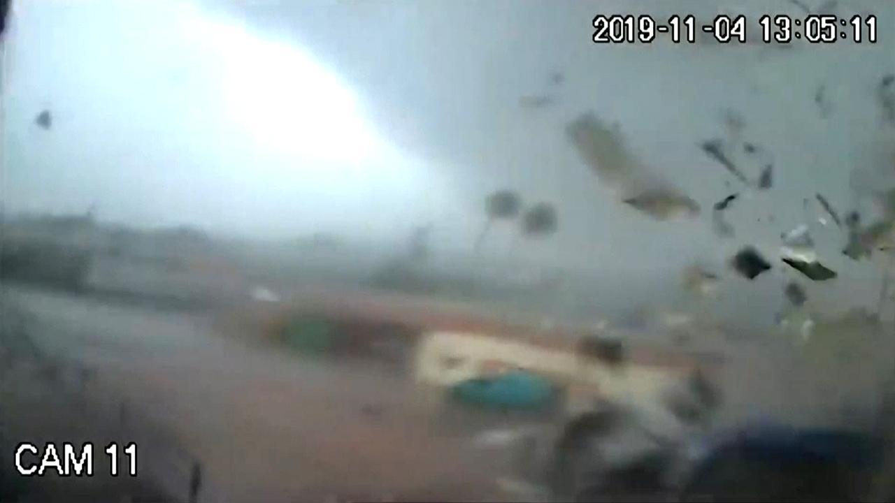 Surveillance cameras capture a tornado tearing across a factory in Greece