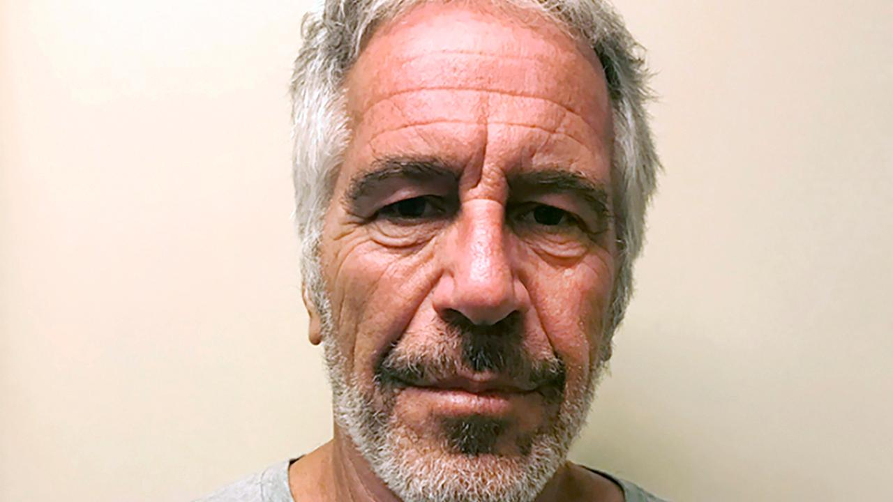 Two correctional officers charged with guarding Epstein charged