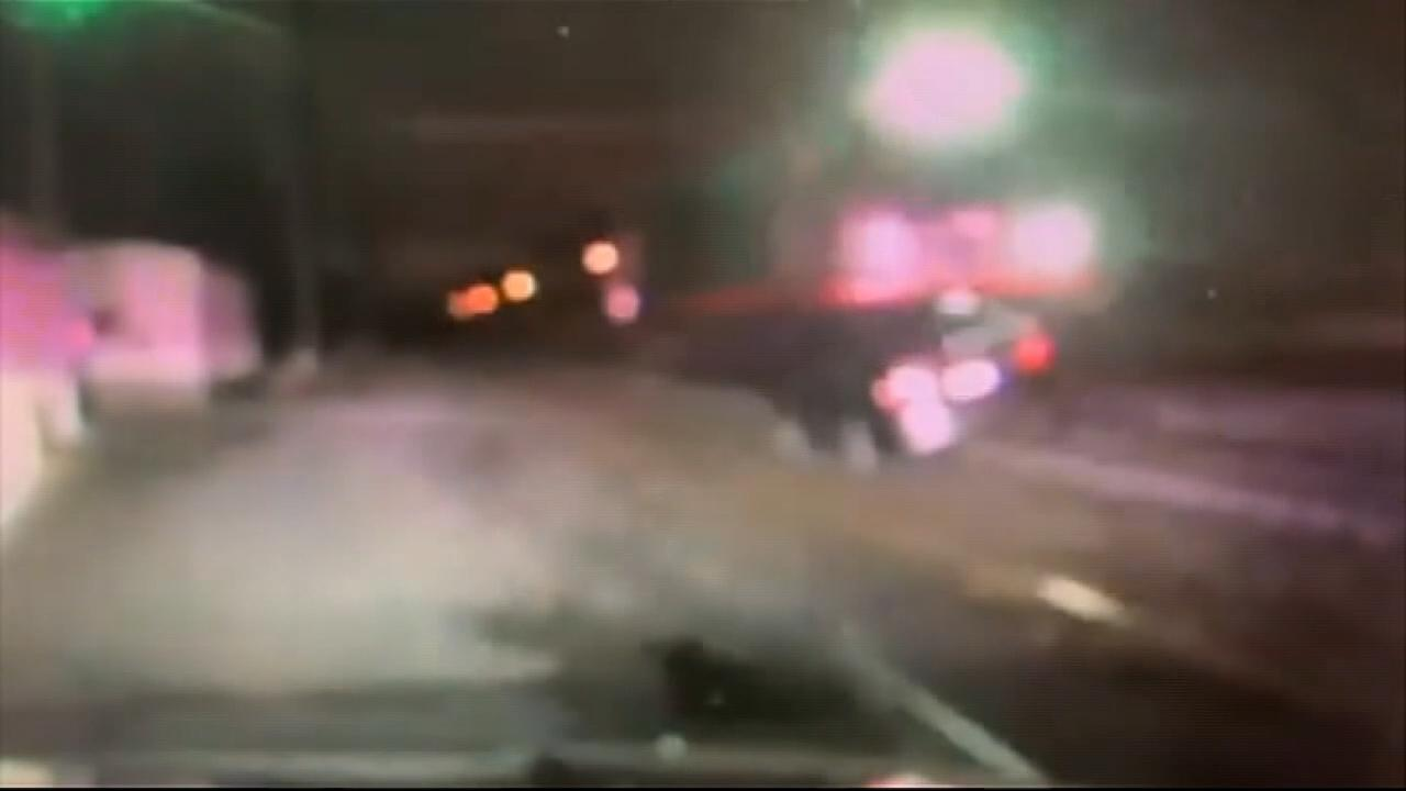 Police dashcam shows moment Amtrak train slams into car on New Jersey tracks