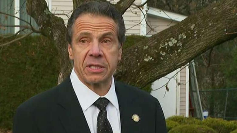 New York Gov. Cuomo helps rescue trapped motorist from wreck