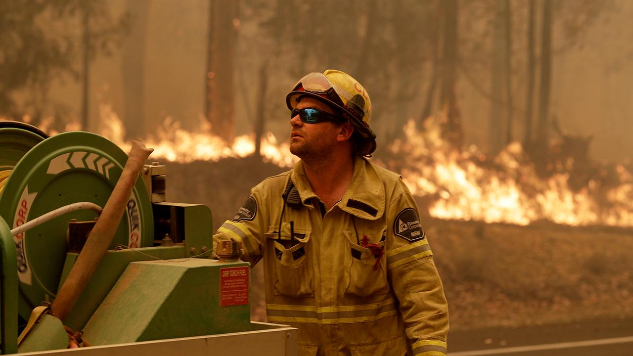 Australia's prime minister calls about 3,000 reservists to help fight deadly wildfires