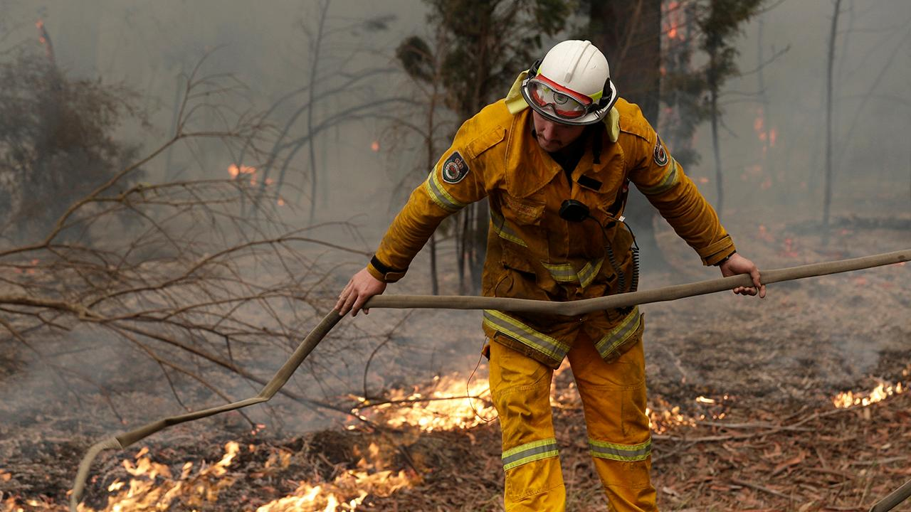 Firefighters in Australia fear warmer temperatures will reignite contained fires