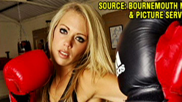 Boxer Banned for Breast Implants