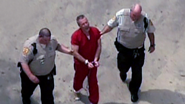 Peterson Arrives at Court in Shackles