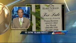 Dow Tops 9000
