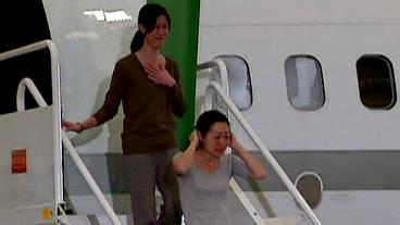 Tearful Arrival of U.S. Journalists