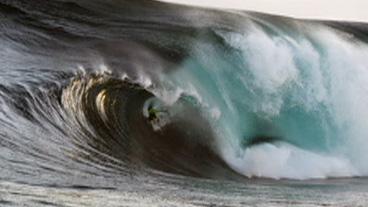Surfer Rides 41 Ft Wave
